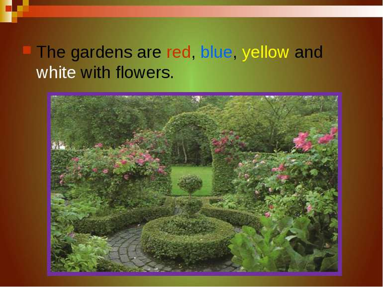 The gardens are red, blue, yellow and white with flowers.