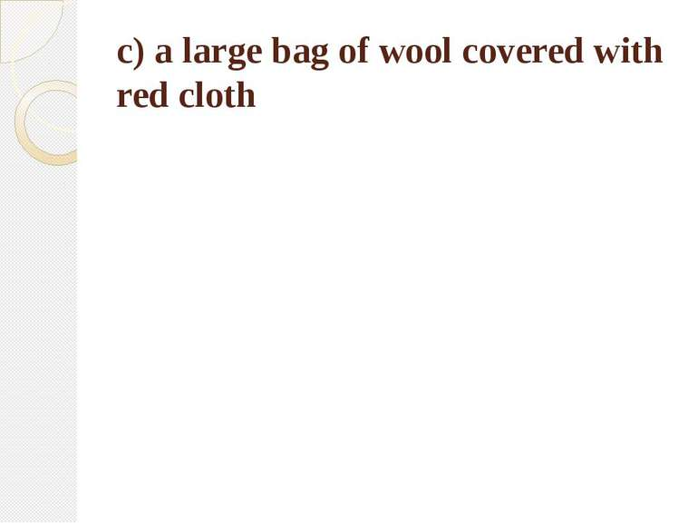 c) a large bag of wool covered with red cloth