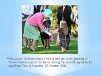 The Queen receives flowers from a little girl in the grounds of Government Ho...