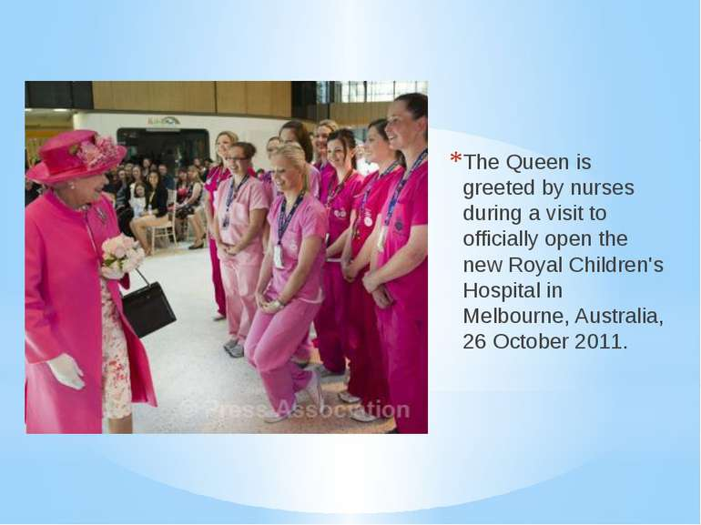 The Queen is greeted by nurses during a visit to officially open the new Roya...
