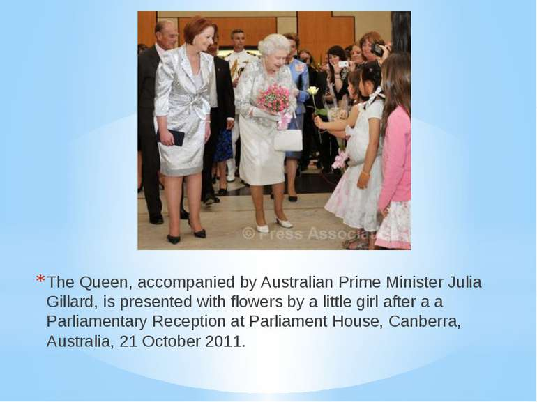 The Queen, accompanied by Australian Prime Minister Julia Gillard, is present...