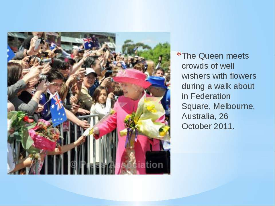 The Queen meets crowds of well wishers with flowers during a walk about in Fe...