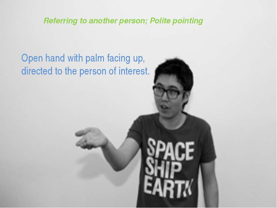 Referring to another person; Polite pointing Open hand with palm facing up, d...