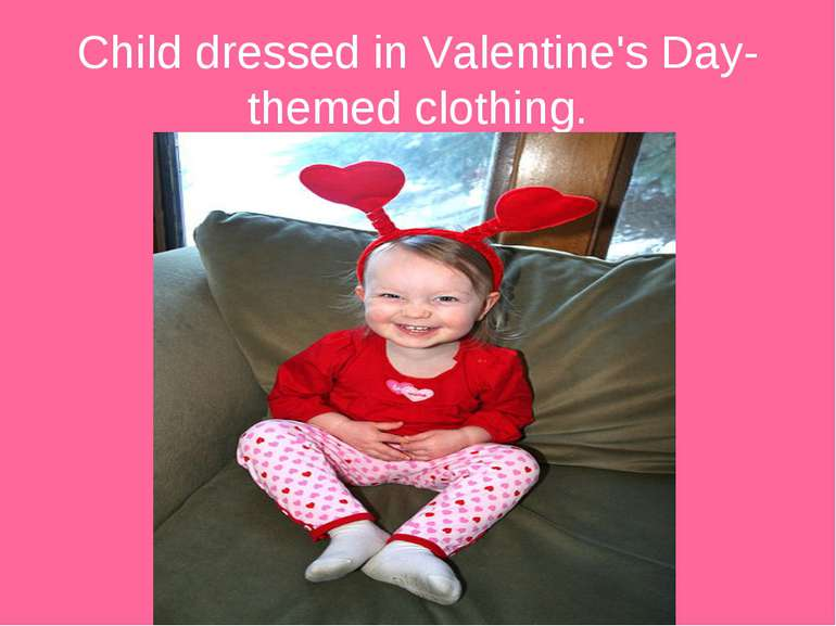 Child dressed in Valentine's Day-themed clothing.