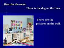 Describe the room. There is the dog on the floor. There are the pictures on t...
