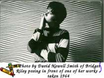 A Photo by David Newell Smith of Bridget Riley posing in front of one of her ...