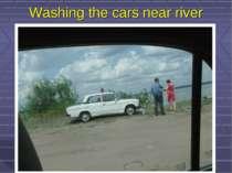 Washing the cars near river
