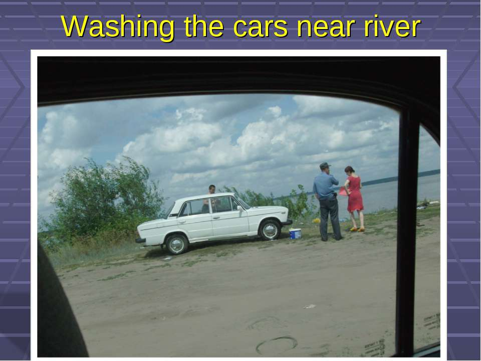 Washing the cars near river
